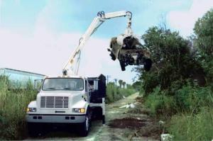 grapple loader illegal dump site