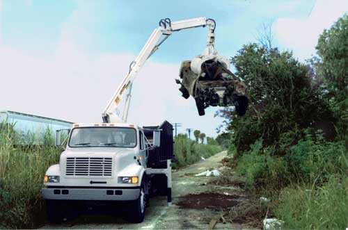 grapple loader illegal dump site